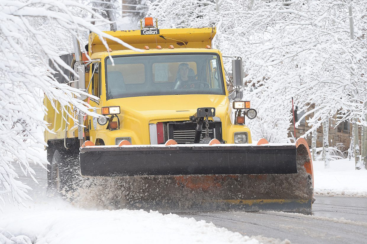 Residents were treated to several inches of fresh snow and the sound of city plow trucks clearing the street Monday morning in downtown Steamboat Springs.