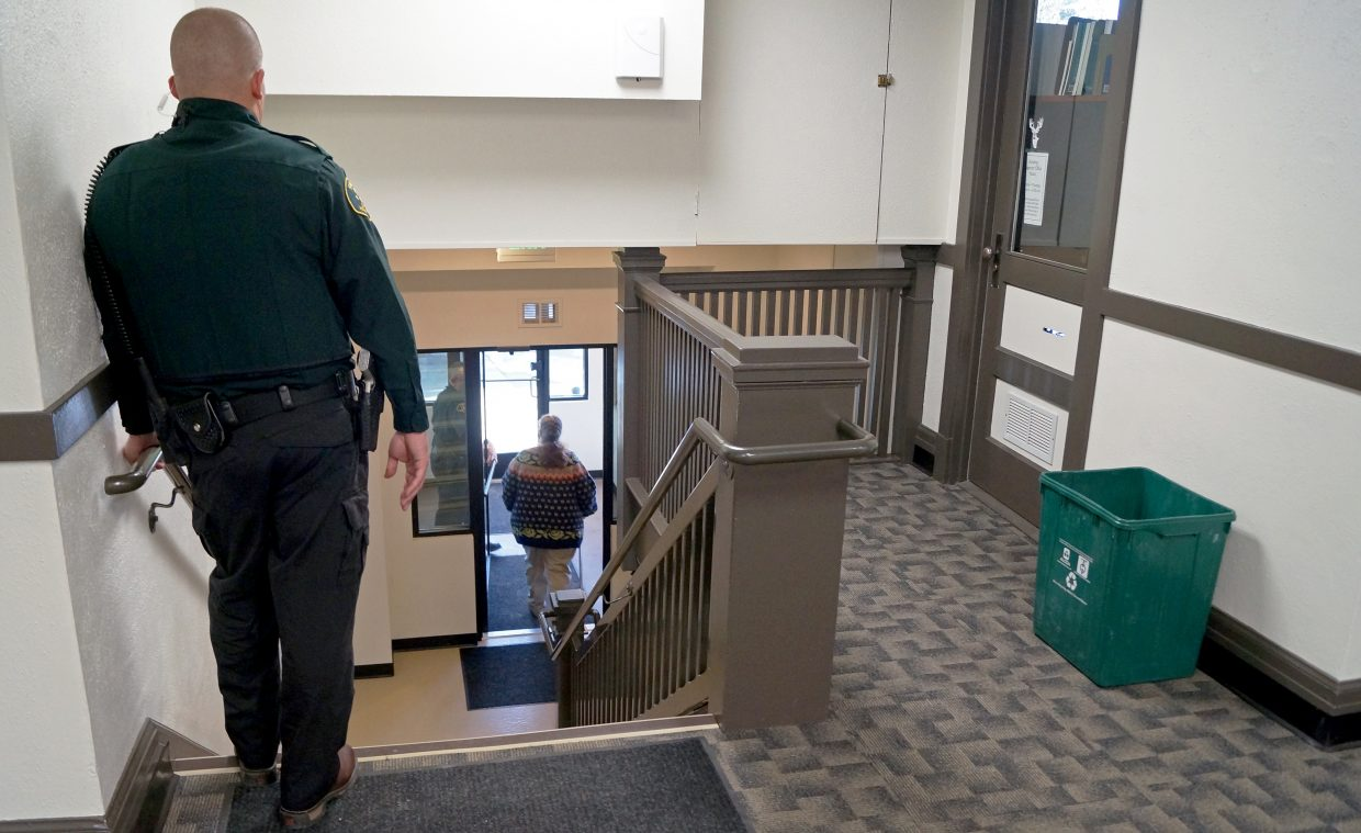 Moffat County Sheriff KC Hume helps escort Georgie Hand out of the Moffat County Courthouse at the end of her second day of trial. One of Hume's deputies was allegedly taken hostage by Hand in the incident for which she is being tried.