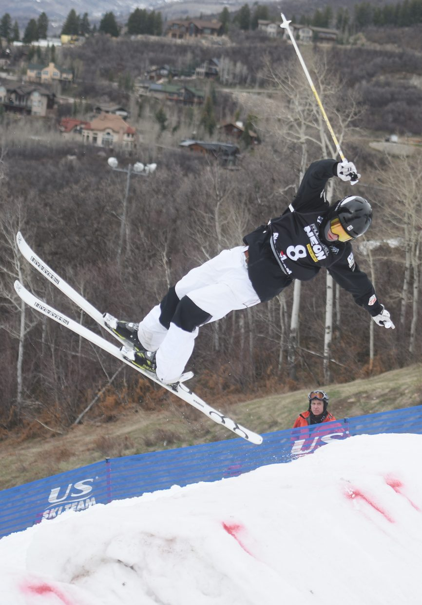 Ryan Dyer twists off the bottom jump Saturday at the U.S. Freestyle Nationals moguls competition Friday in Steamboat Springs.