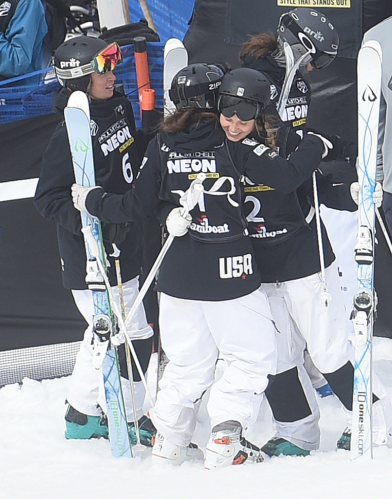 Morgan Schild, right, trades hugs with Jaelin Kauf, No. 1, Friday after the U.S. Freestyle National Championships women's moguls finals. Schild won the event while Kauf was third.