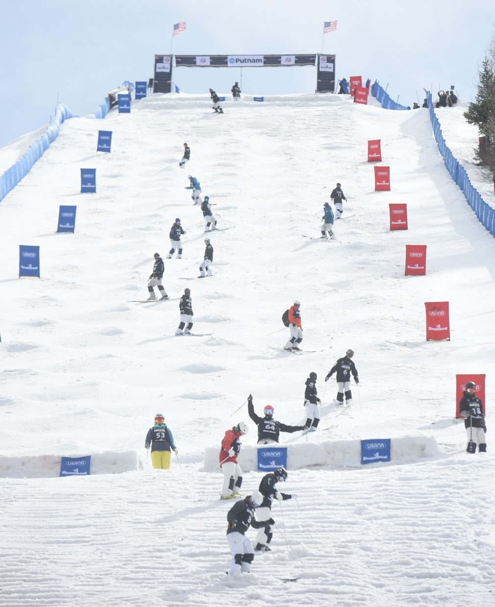 More than a dozen skiers make their way down Voodoo run at Steamboat Ski Area on Friday before the U.S. Freestyle National Championship finals.