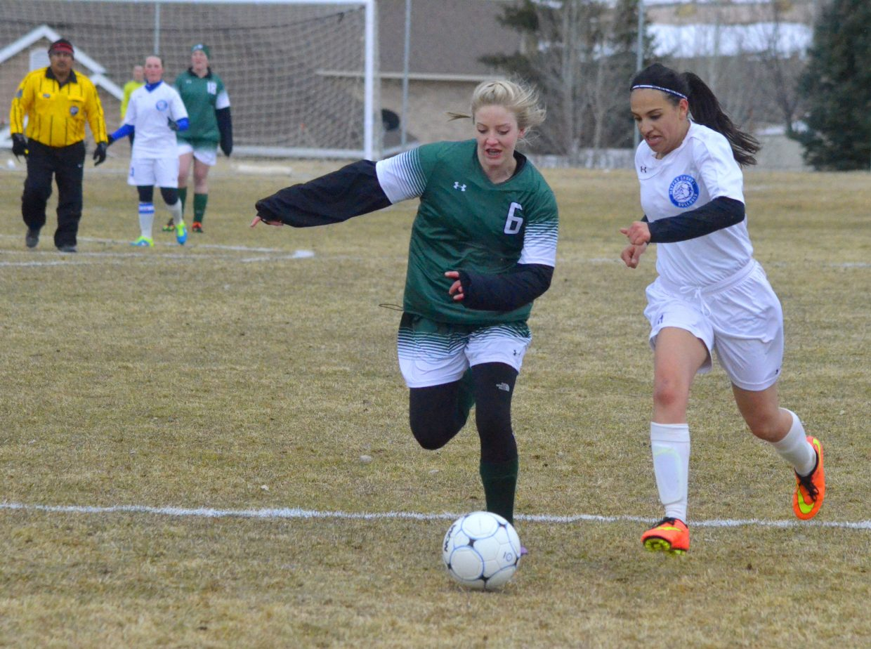 Moffat County High School's Candy Tarango battles for the ball during the girls soccer team's home game against Rangely. The team took a pair of road losses this week, falling to Middle Park, 6-0, Tuesday in Granby and 1-0 Thursday in Basalt. The Bulldogs recorded a total nine shots in the two games, with goaltender Hannah Walker making 64 saves. Now 0-6 overall, the squad will host Steamboat Springs April 11 following the school's spring break.