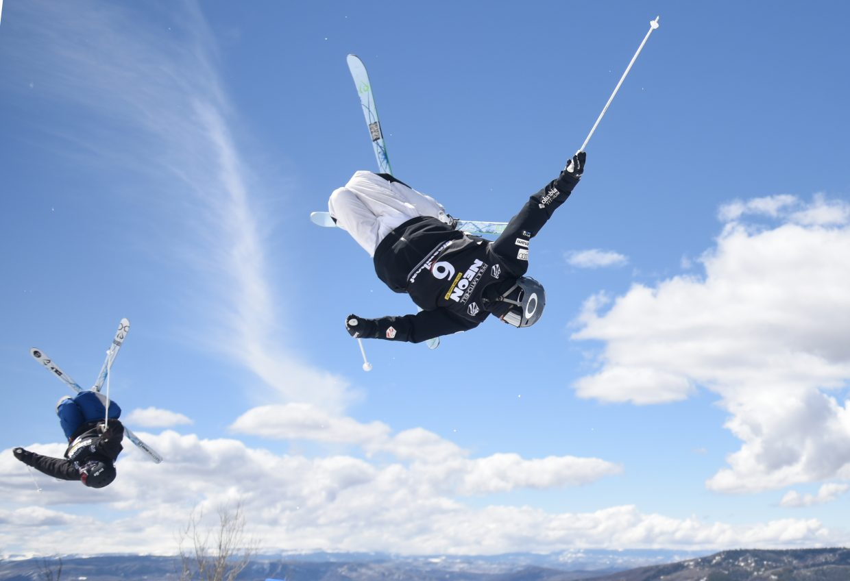 Hunter Bailey, right, flies high about the Yampa Valley on Saturday during the U.S. Freestyle National Championships dual moguls competition in Steamboat Springs. Bailey won Friday's moguls national championship, then came back and won again on Saturday in dual moguls.