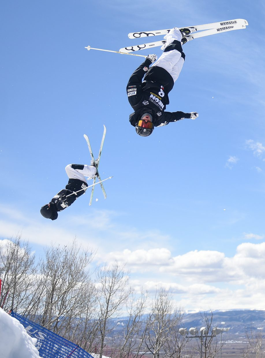 Steamboat Ryan Dyer, right, flies through a trick Saturday during the U.S. Freestyle National Championships in Steamboat Springs. Dyer went on to finish eighth.