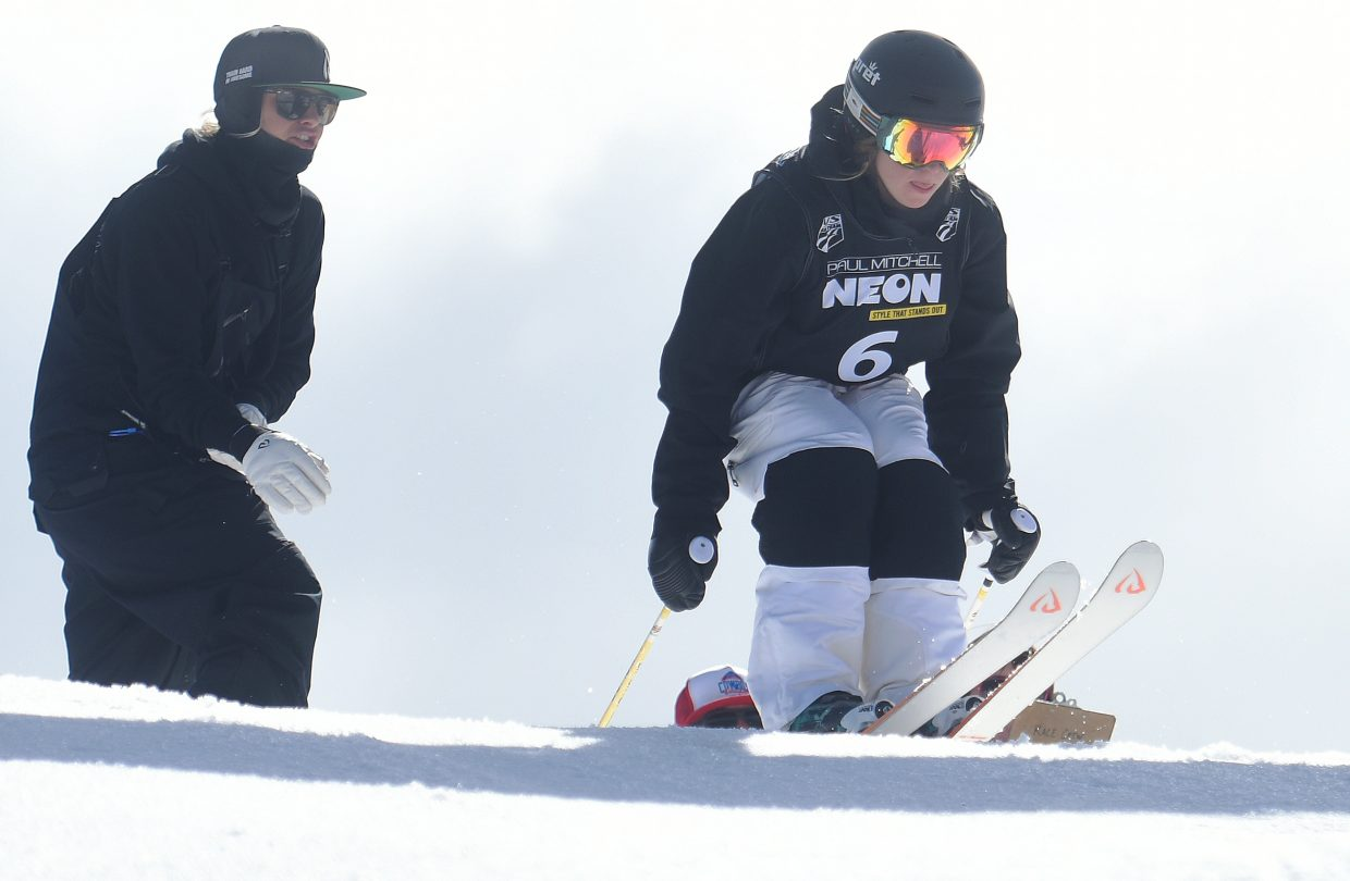 Steamboat Springs moguls coach Kate Blamey shouts encouragement as Avital Shimko launches into the moguls run at the U.S. Freestyle National Championships in Steamboat Springs.