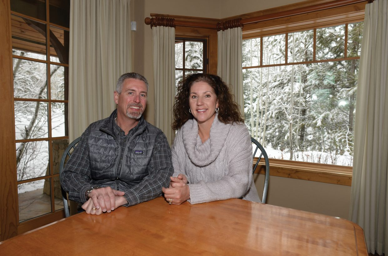 """Jim and Leagh Boyne sit in the dining area of their home in Steamboat Springs. The Boynes' move from Chicago to Steamboat Springs will be featured on one of HGTV's reality television shows, """"New House, New Life."""""""