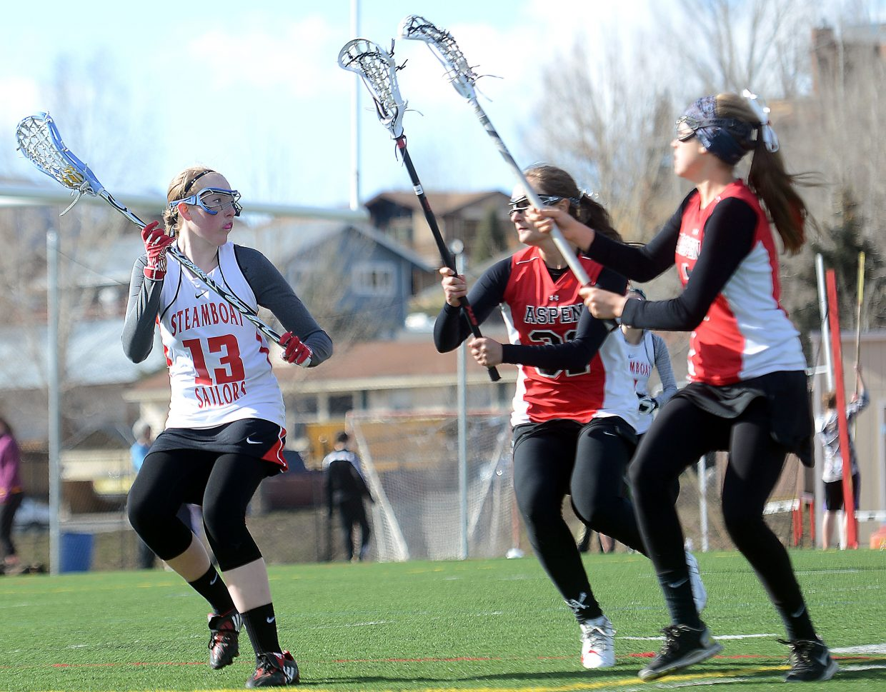 Steamboat Springs' Ellie Crouch looks for a way out as the Aspen defense closes in Thursday during the Sailors 17-0 loss.