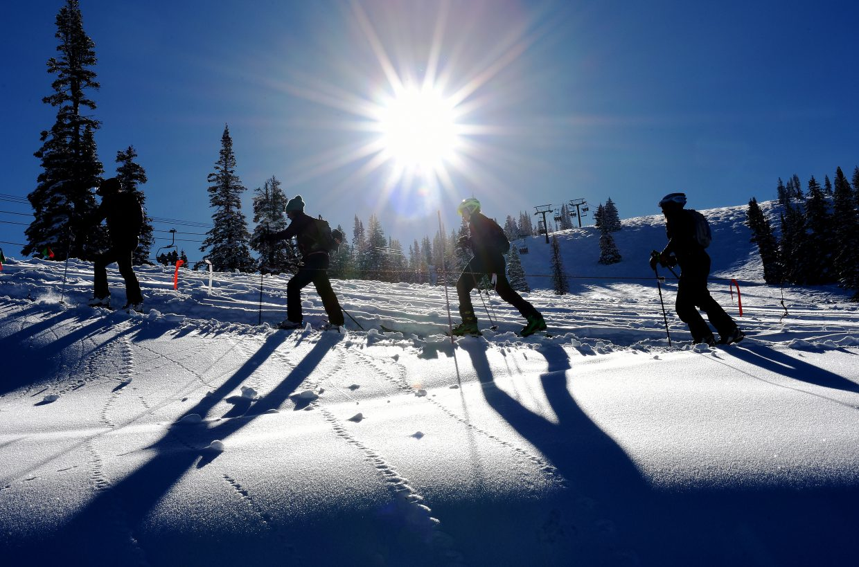 Skiers make their way up Mount Werner on Saturday during Cody's Challenge race at Steamboat Ski Area.