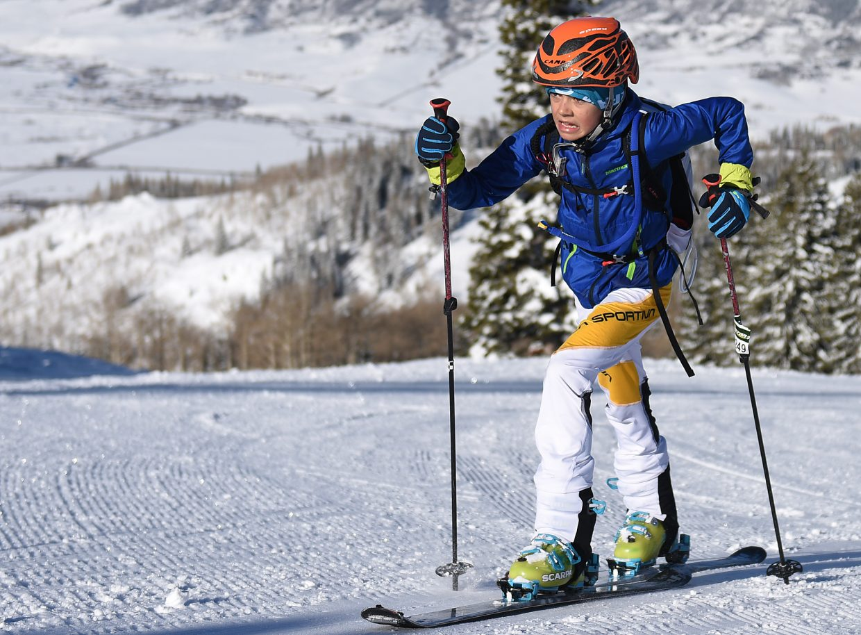 Max Kilcoyne, 14, races up Mount Werner Saturday during Cody's Challenge in Steamboat Springs.