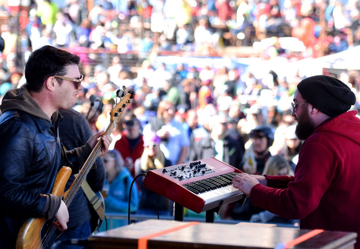 James Searl, left, on bass, and Tony Gallicchio, on the keyboard, play with the band Giant Panda Guerilla Dub Squad on Saturday afternoon in Gondola Square at the base of Steamboat Ski Area.