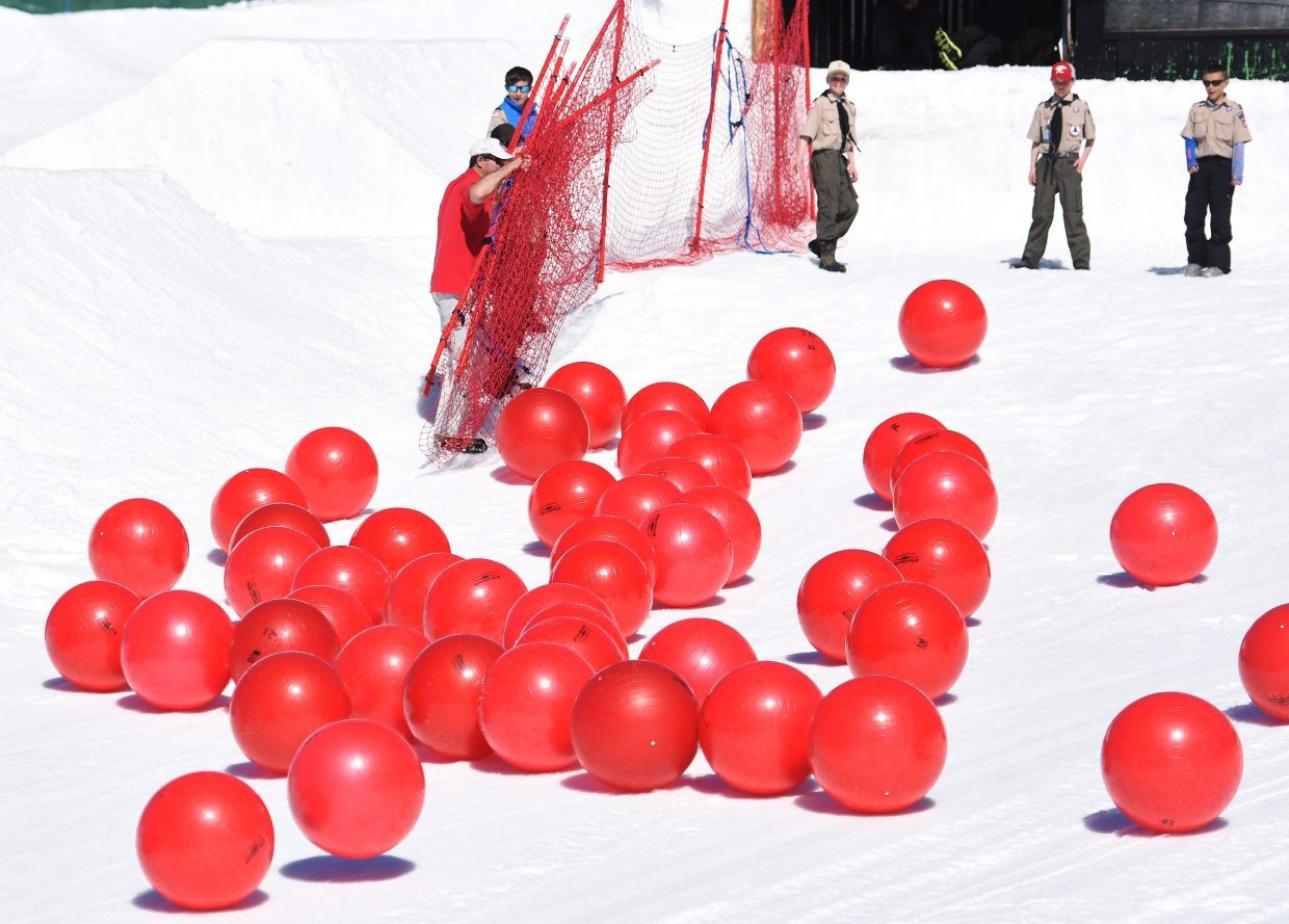 Boy Scouts watch as a herd of red balls roll toward the base of Steamboat Ski Area during Ski Town USA Rotary Club's second-annual Red Ball Express fundraiser.