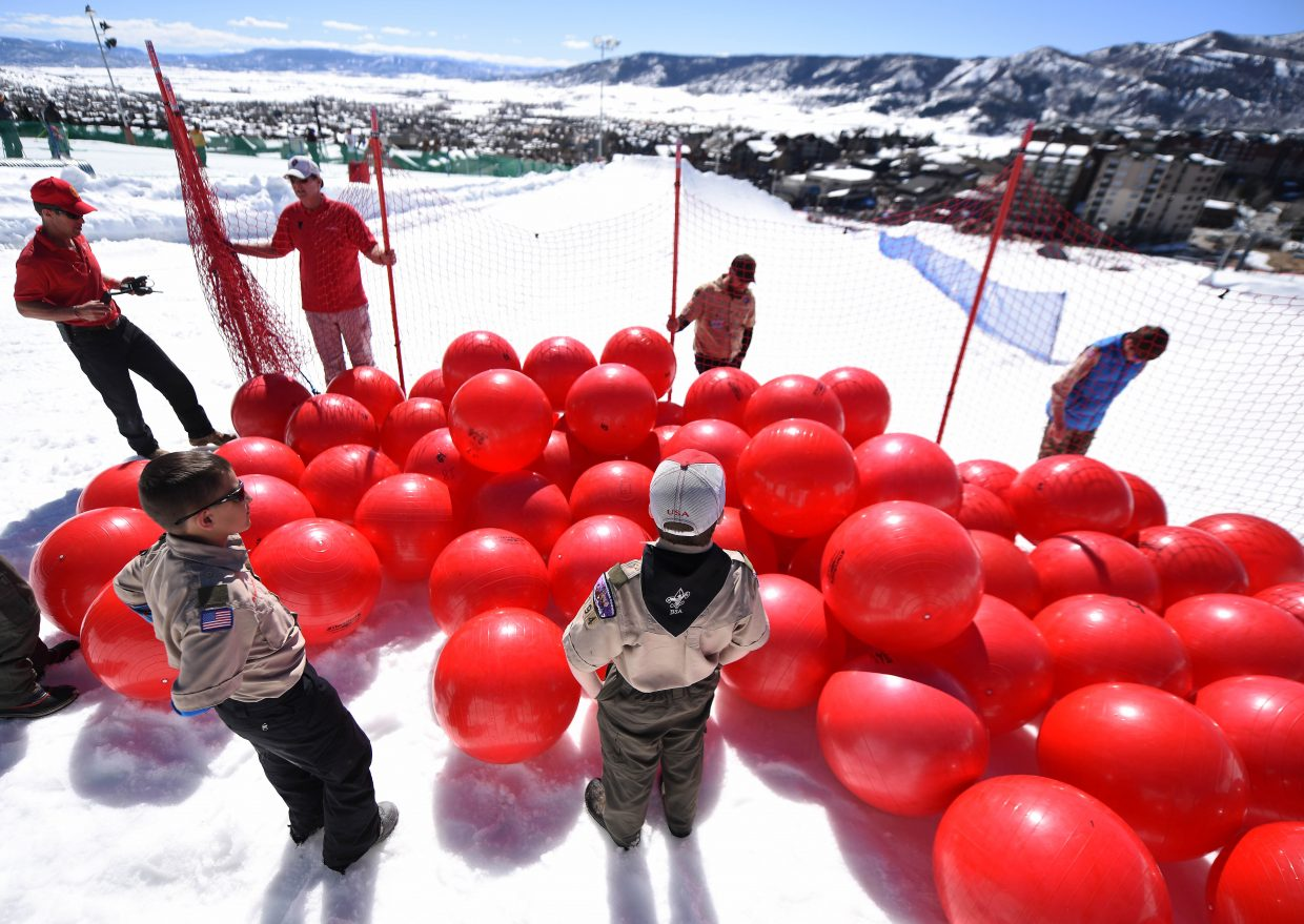 Boy Scouts wait for the order to unleash a corral of red balls at the base of Steamboat Ski Area during Ski Town USA Rotary Club's second-annual Red Ball Express fundraiser.