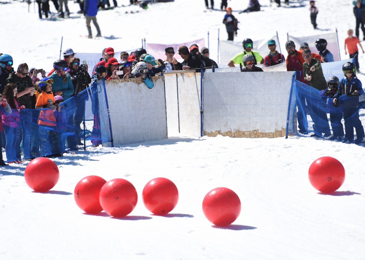 Red balls roll toward the finish corral the base of Steamboat Ski Area during the second-annual Red Ball Express fundraiser.