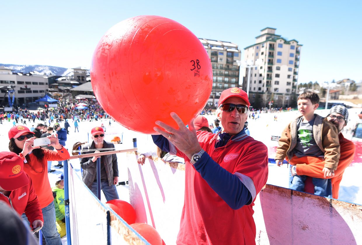 Bob Kuusinen calls out a number from one of the balls in the second-annual Red Ball Express fundraiser at Steamboat Ski Area.