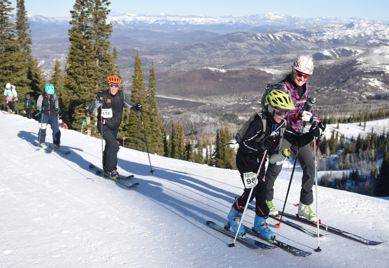 Kade Lawton, 9, and his mother, Amy Lawton, work their way up the Cody's Challenge course at Steamboat Ski Area on Saturday. Kade tackled the course this year for the first time after his parents, Amy and Kyle Lawton, have helped organize the event since its first year, in 2008.