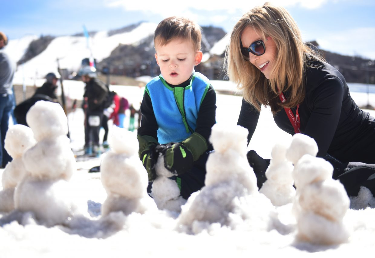 Do you want to build a snowman? -- Sawyer Wright, 2 years old and visiting from San Antonio, adds the finishing touch to yet another snowman with some help from his grandmother, Debbie Rasa, a second-home owner in Steamboat Springs. The family played in the snow at the base of Steamboat Ski Area on Saturday morning as Sawyer took a break from what was his first day learning to ski.