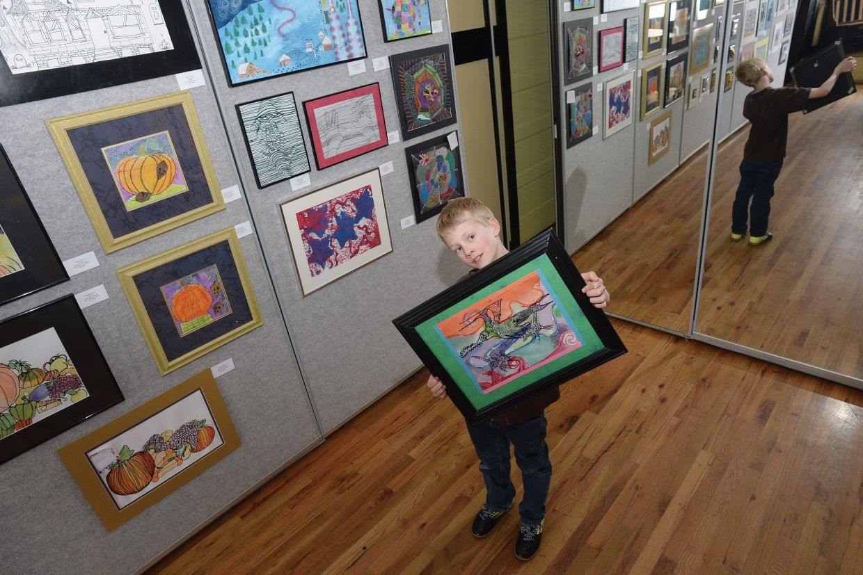 Soda Creek Elementary School third-grader Olin Webster holds his art inside the Depot Art Center in Steamboat Springs. The Routt County Youth Art Show will open Friday.