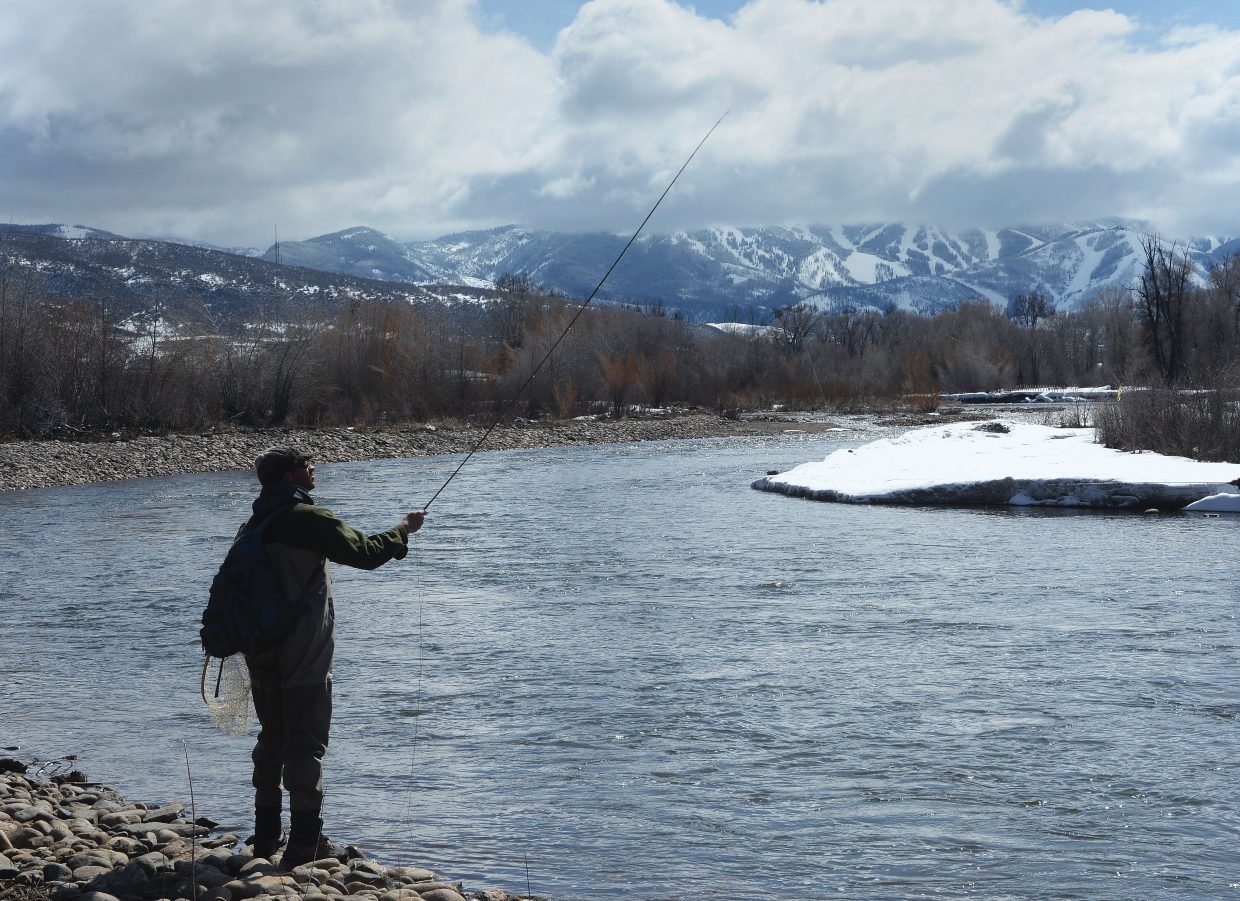 Fisherman Dana Stephenson tests the waters of the Yampa River on the west side of Steamboat Springs on Thursday afternoon.