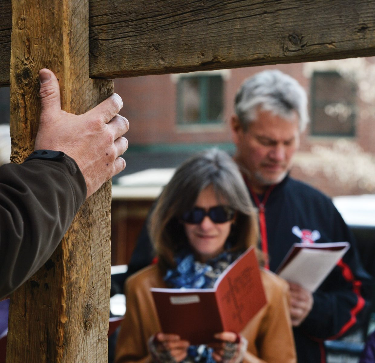 Mary Ann and Billy Gunn read a passage of scripture while taking part in this year's Stations of the Cross in downtown Steamboat Springs. The Stations of the Cross, or the way of the Cross, which is a symbolic pilgrimage highlighting the suffering of Christ as he made his way to Calvary. The group stopped at 14 different locations in downtown Steamboat Springs, stopping at each for a few moments of prayer. The annual remembrance is just one of many events leading up to Easter Sunday.