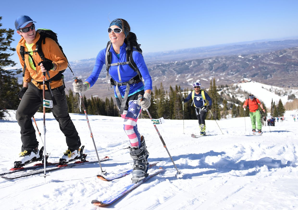 Katie Everson, right, and Zachary Snavely race Saturday in Cody's Challenge, a ski mountaineering event at Steamboat Ski Area. The event drew more than 170 racers, the most in its history.