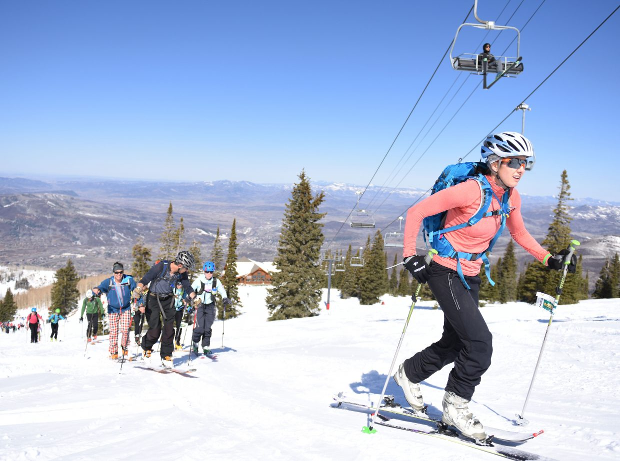 There's more than one way up a mountain. Sunny Owens works her way up during Saturday's Cody's Challenge event while another skier rides the Storm Peak Express chairlift.