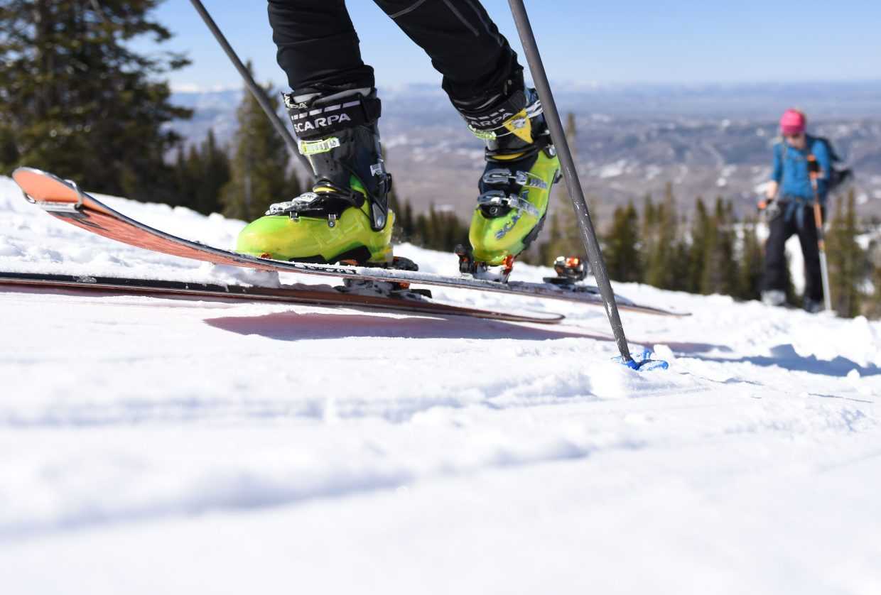 A skier climbs Mount Werner on alpine touring gear Saturday during Cody's Challenge.