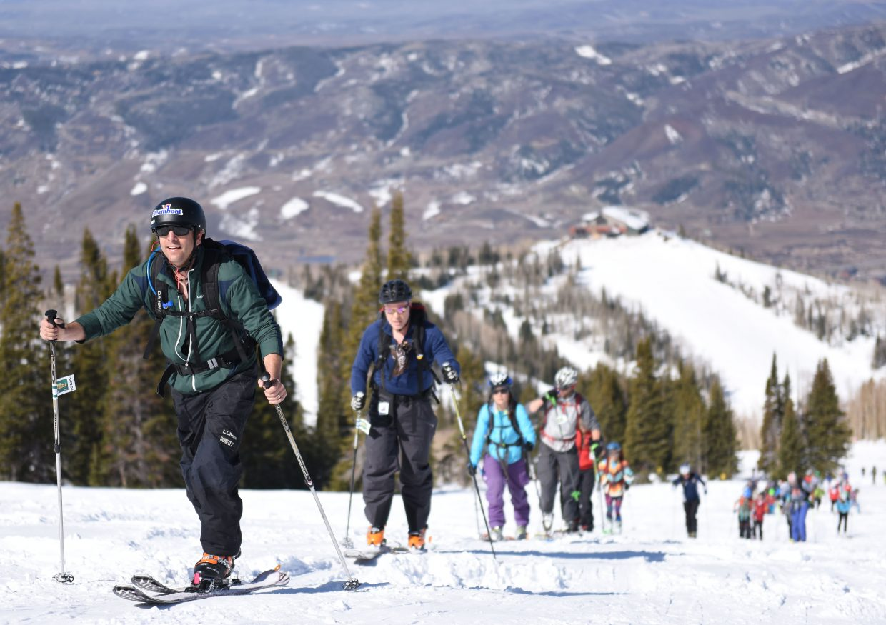 Chuck Cerasoli skis up Mount Werner on Saturday during Cody's Challenge.