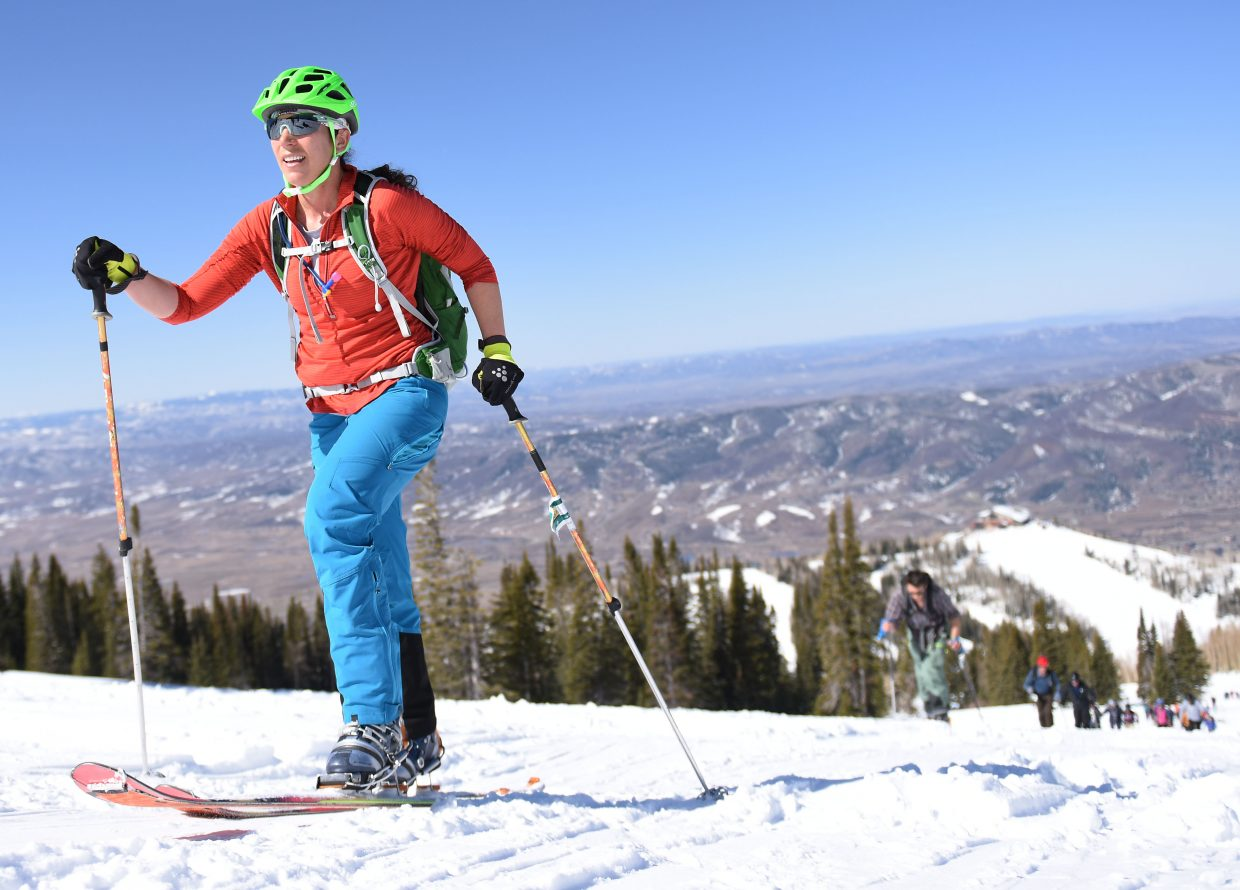 ElisaMaines climbs Mount Werner Saturday during Cody's Challenge.
