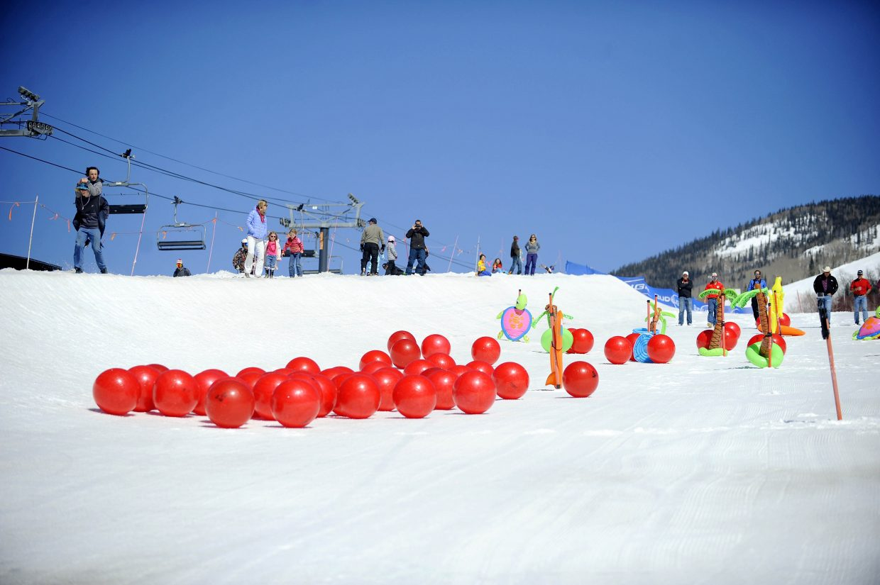 Red balls roll down the halfpipe Saturday at the base of the Steamboat Ski Area during the Ski Town USA Rotary Club's inaugural Red Ball Express fundraiser.