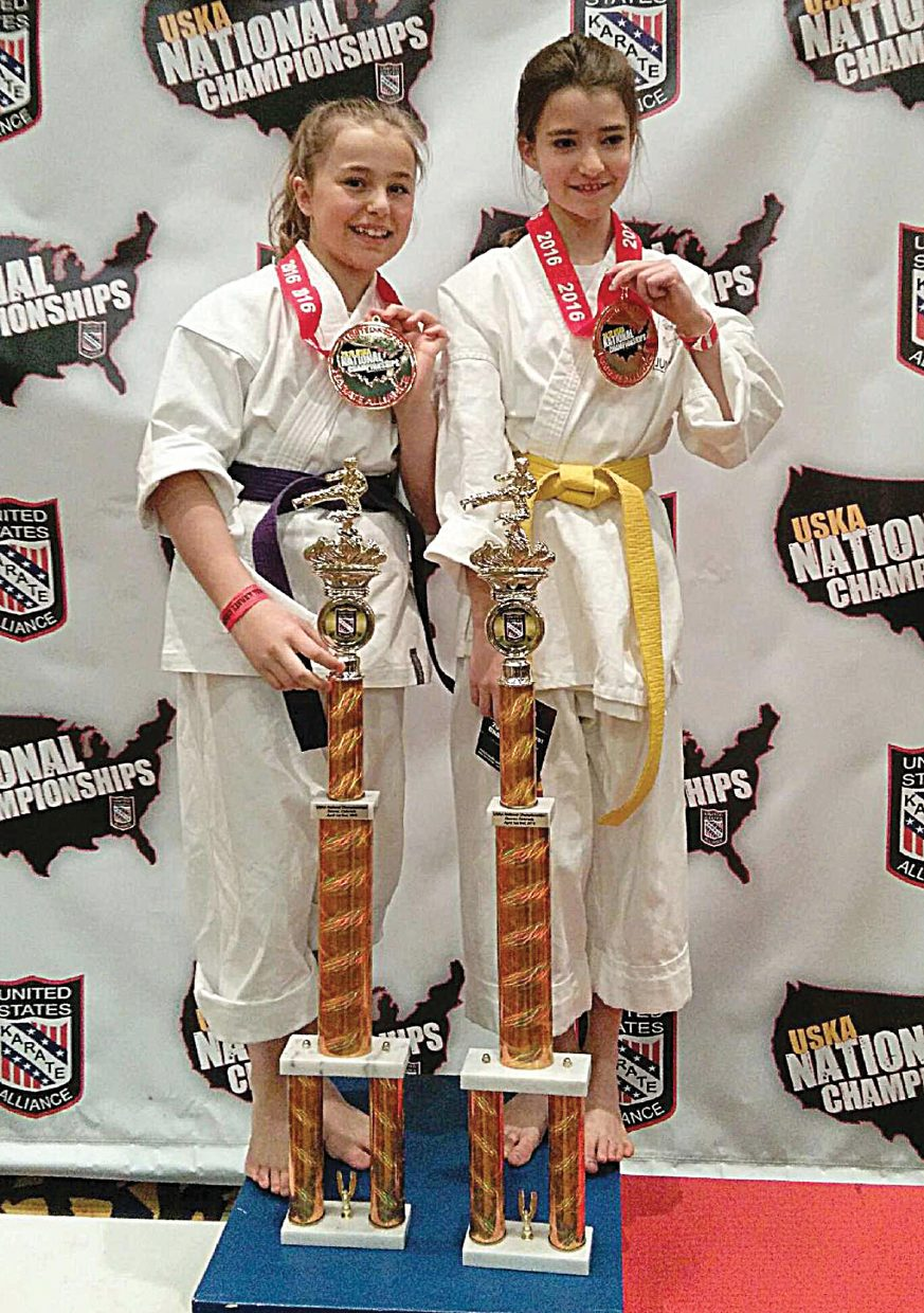 Steamboat Springs karate students Jordan Ward, left, and Delaney Parker, right, returned home from the USKA National Championships, which were held last week in Denver, with national titles in their divisions.