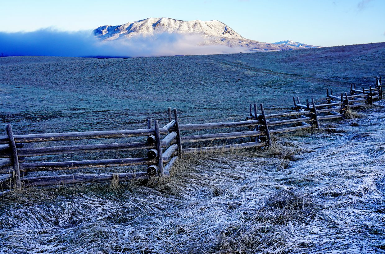 Sleeping Giant thaws out during sunrise after a spring snowstorm.