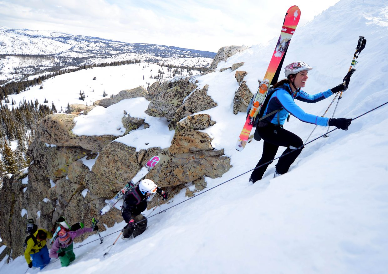 Elisa Maines leads a pack of skiers between the rocks and up Rancid Tuna at Steamboat Ski Area on Saturday during the sixth annual Cody's Challenge randonee race. The event enjoyed a banner year, drawing twice as many racers as it did a year ago, with 160 beginning the grueling up-and-down course at the top of the gondola.