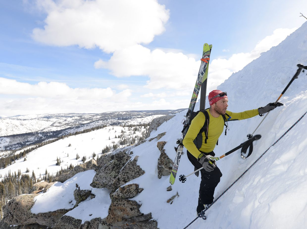 Emannuel Louissus takes the final steps to the top of the Rancid Tuna couloir Saturday at Steamboat Ski Area during Cody's Challenge.