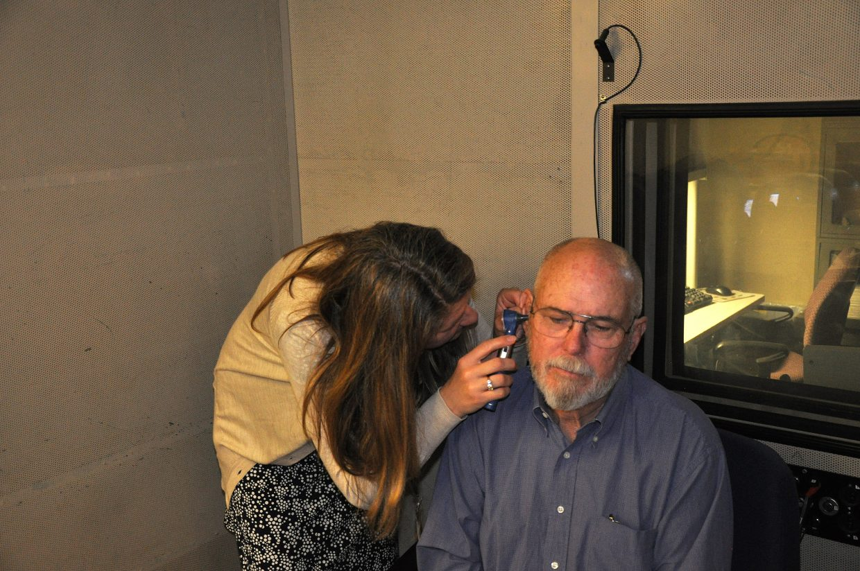 Audiologist Tori Thompson checks Jim McGee's ears during McGee's visit to the Grand Junction VA Medical Center.