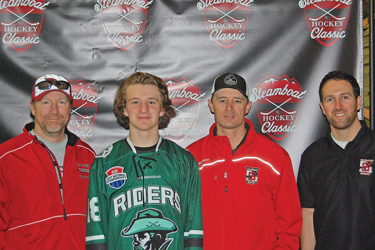 Sean Sullivan, third from the left, credits coaches Brian Romig, Brian Ripley and Nick Carelli, pictured from left, for giving him a good start in hockey. He is now playing with a AAA Tier 1 team on the Front Range and will compete for a national title this weekend.
