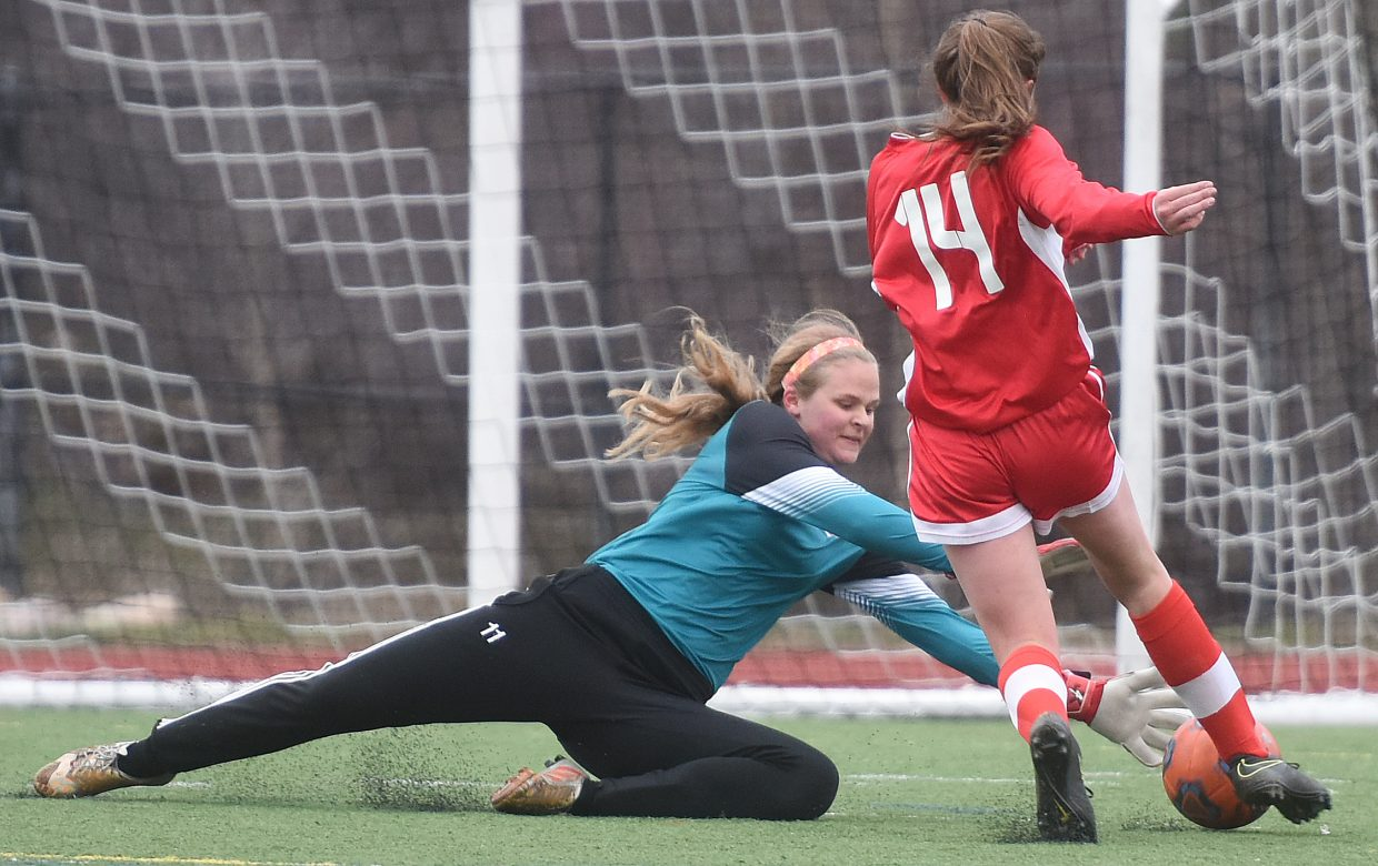 Steamboat goalie Leah Rowse dives just in time to save a goal Wednesday night as the Sailors played against Glenwood Springs. She got that one, but the Demons managed a 3-1 win.