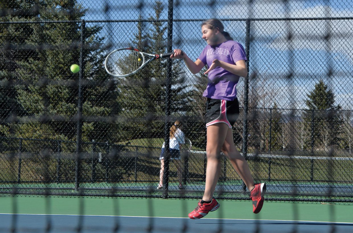 Steamboat Springs High School tennis player Emmie Thompson returns a shot while practicing at the Tennis Center at Steamboat Springs Monday afternoon. The team is preparing for road matches against Ralston Valley, Boulder and Air Academy this weekend.