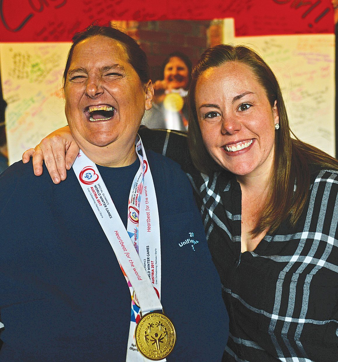 Sue White, just back from Austria where she competed in the Special Olympics World Winter Games, hugs Meghan McNamara, who works for Horizons in Steamboat Springs. McNamara used vacation time and paid her own way to go see the Games and support White.