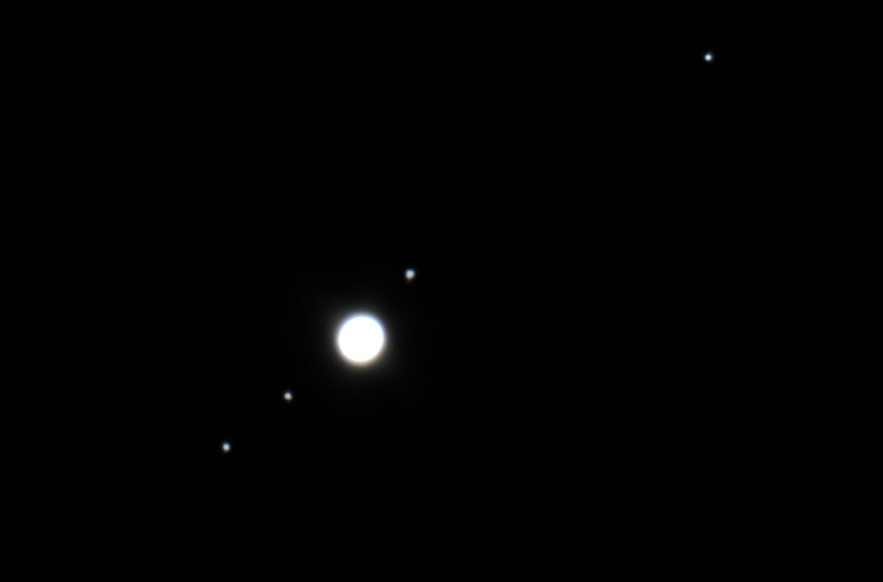 With Jupiter passing close to Earth this month, it is a perfect time to aim your binoculars or telescope at the giant planet and see its four planet-sized moons. Discovered by famed Italian astronomer Galileo Galilei in 1610, the four moons demonstrated that all objects did not revolve around the Earth and that a planet could orbit the sun and not leave its moons behind. This telescopic image was taken on Sept. 21, 2011 and shows the bright ball of Jupiter, with moons Io and Europa below and Ganymede and Callisto above.