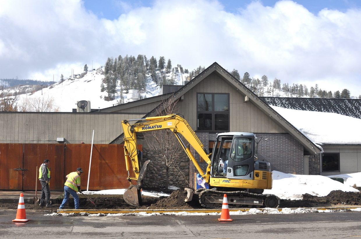 Crews with Duckels Construction work to install a new sidewalk on Yampa Street in 2014. Under a potential urban renewal plan, a promenade would be installed on Yampa.