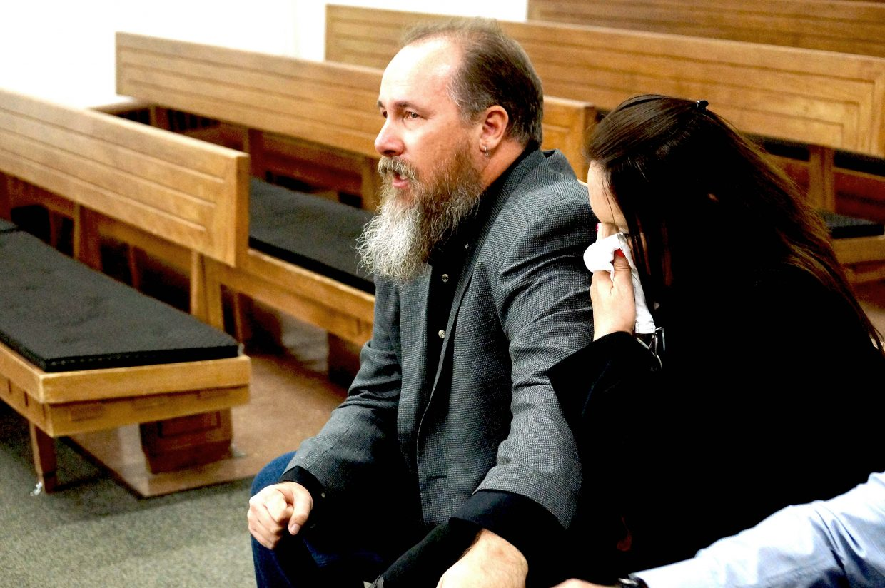 Bhrent Shock sits in the courtroom with his wife Jane Shock, listening to the judge read the verdict in Georgie Hand's trial. Bhrent Shock was held at gunpoint by Hand and her ex-husband James Damon on March 9, 2015. Hand was found guilty on all counts.