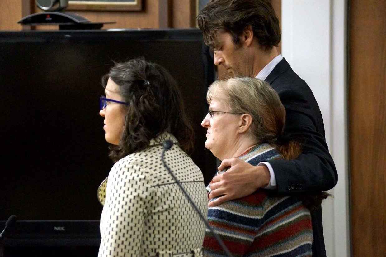 Georgie Hand's lawyers stand by her side as 14th Judicial District Judge Shelley Hill reads the verdict in Hand's trial. Hand was represented by Rico Tagliaferri and Molly Hamshire.