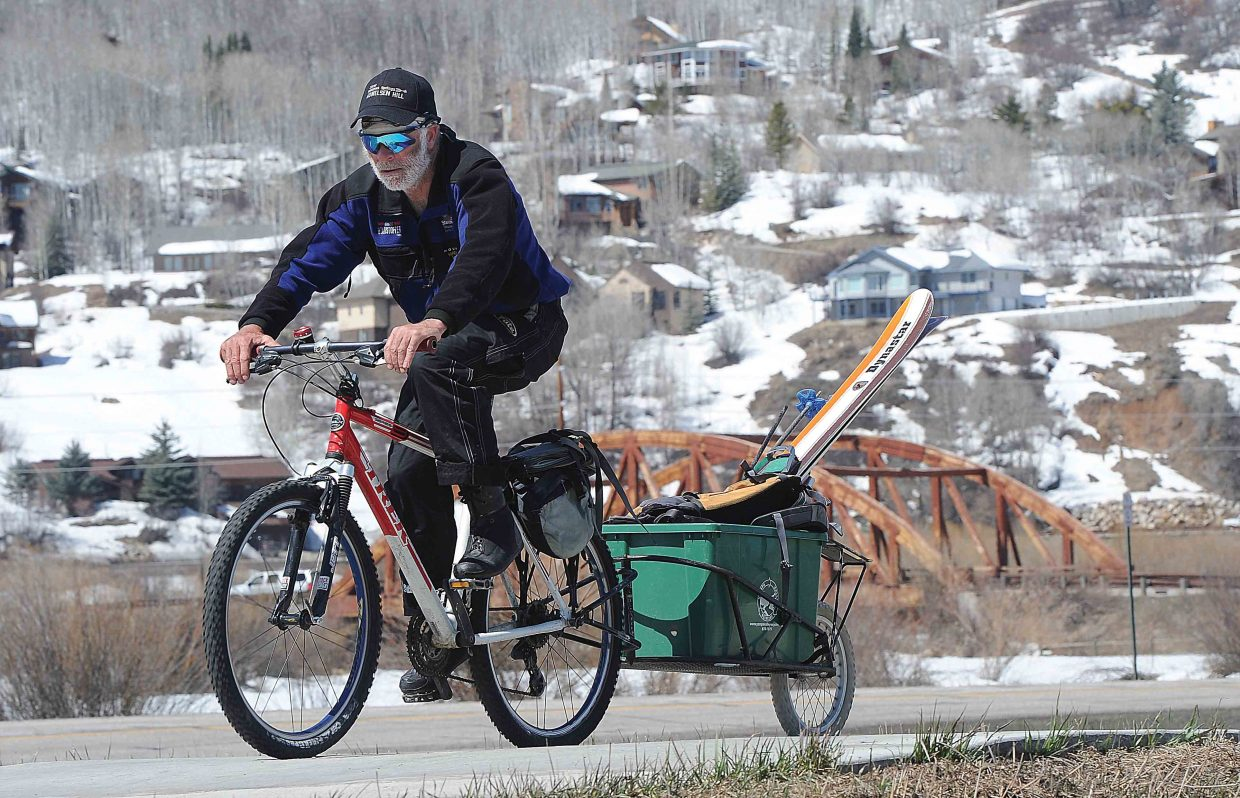 Pauly Klemmer rides his bicycle along the Yampa River Core Trail Thursday en route to the slopes of the Steamboat Ski Area, where he hoped to log another day on the slopes. The sun is setting on the ski season in the Yampa Valley as the Steamboat Ski Area readies to host the final weekend of skiing for the 2015-16 season.