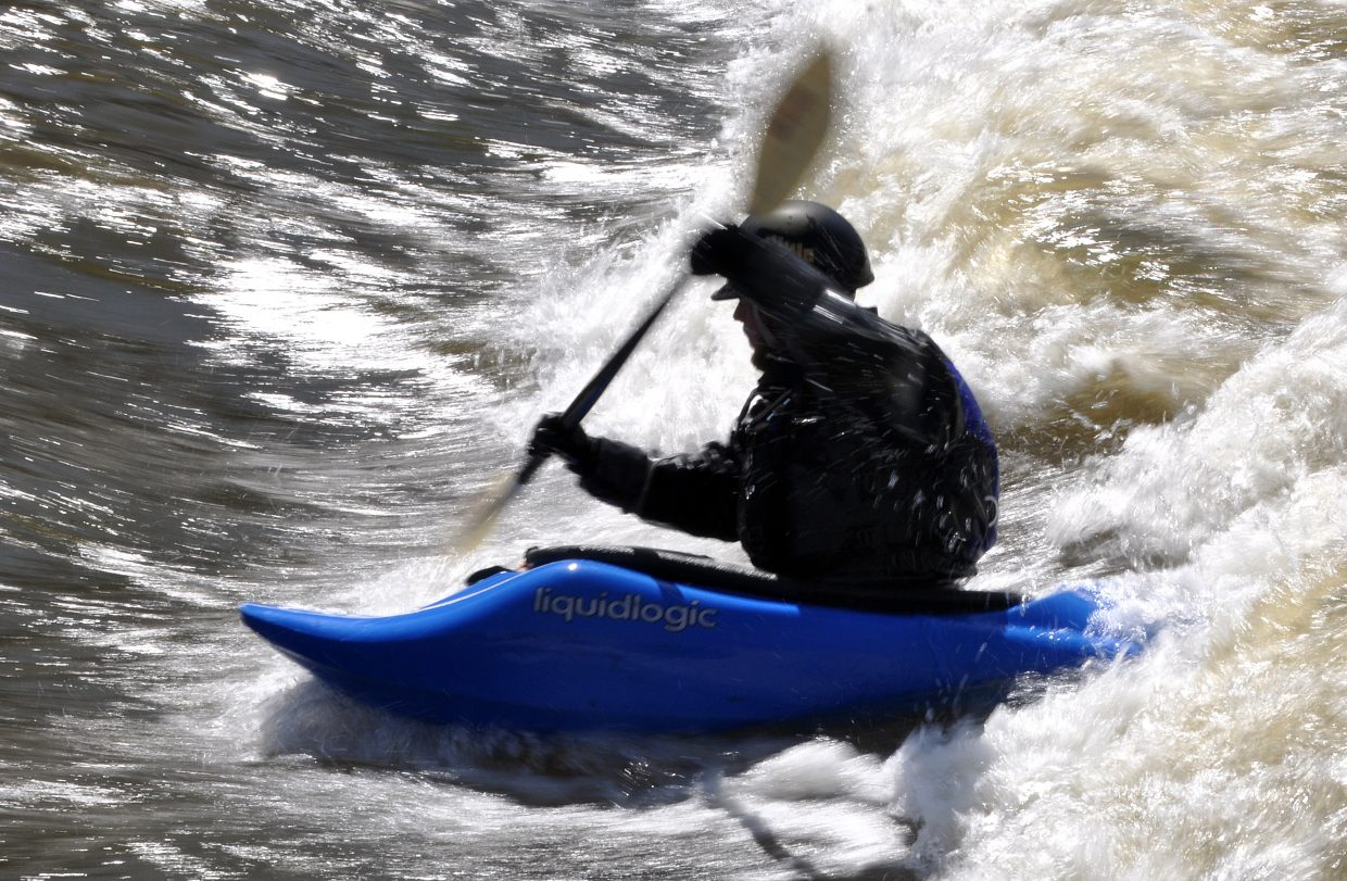 Casey Durbin battles the swift current of the Yampa River on Tuesday near downtown Steamboat Springs.