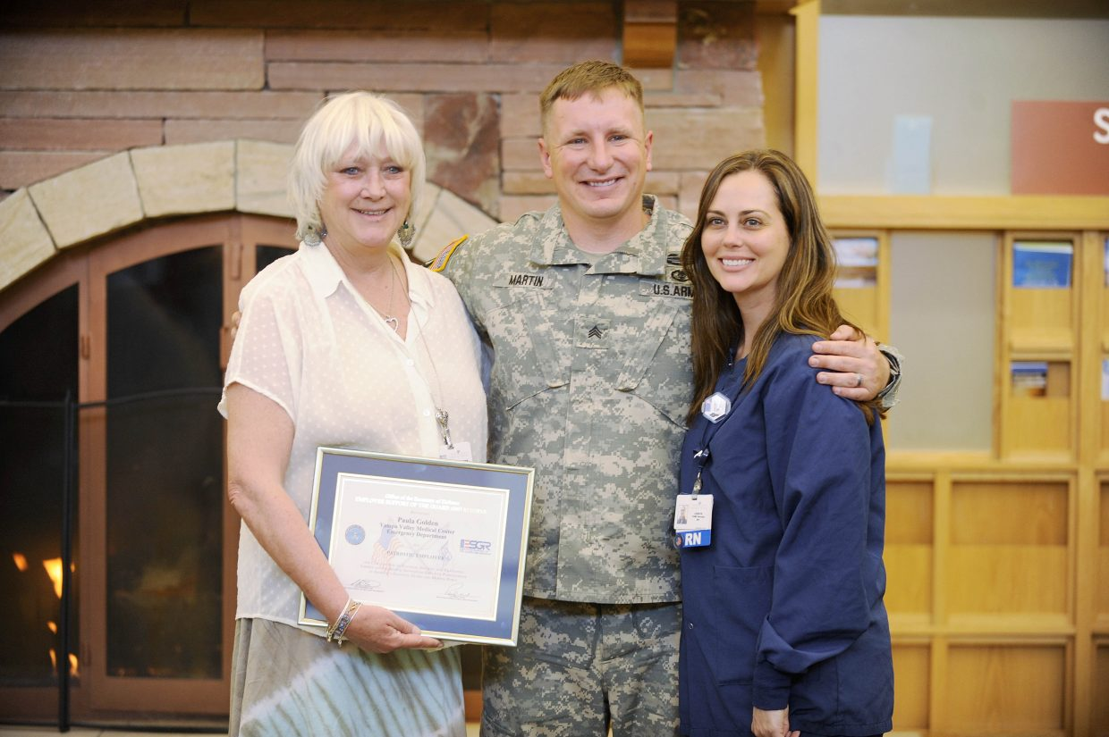 Yampa Valley Medical Center Emergency Department technician Bret Martin poses with his wife, Lenaya, right, and Emergency Department Director Paula Golden, who was presented with the Patriot Award Wednesday.