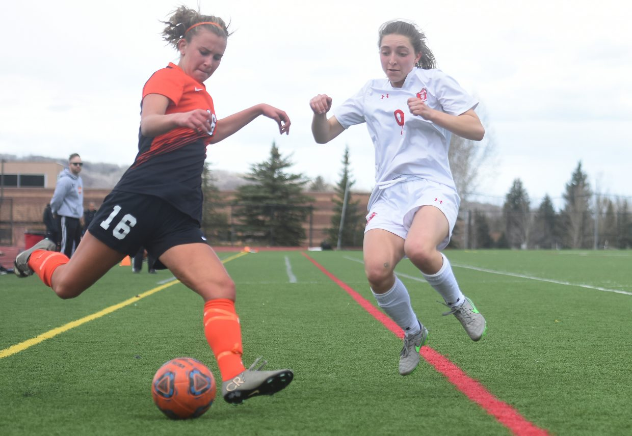 Lewis-Palmer's Sammy Kazlausky winds up for a shot as Steamboat's Teegan Ludwick leaps in to defend Saturday. Steamboat went on to lose the game, 6-0.