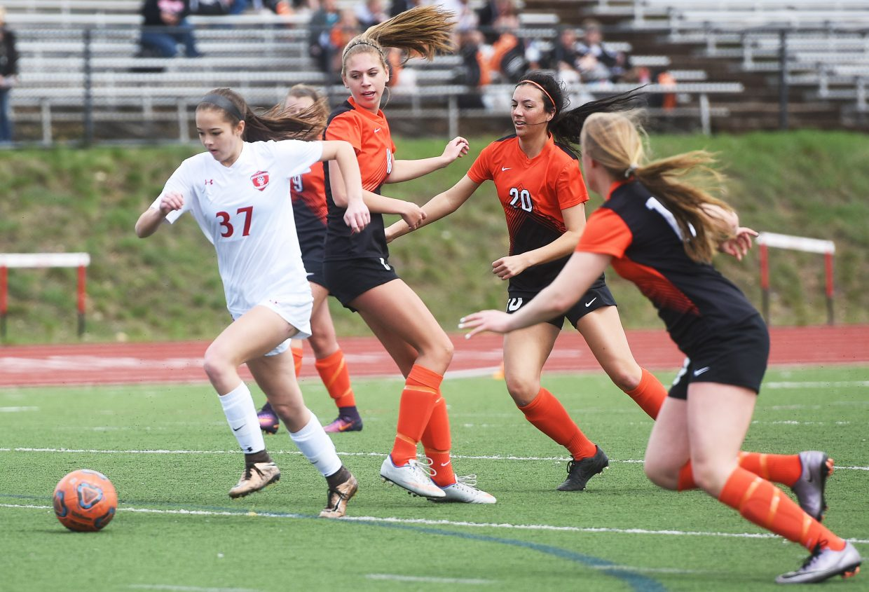 Steamboat freshman Holland Reese tries to break away from a pack of Lewis-Palmer defenders on Saturday.
