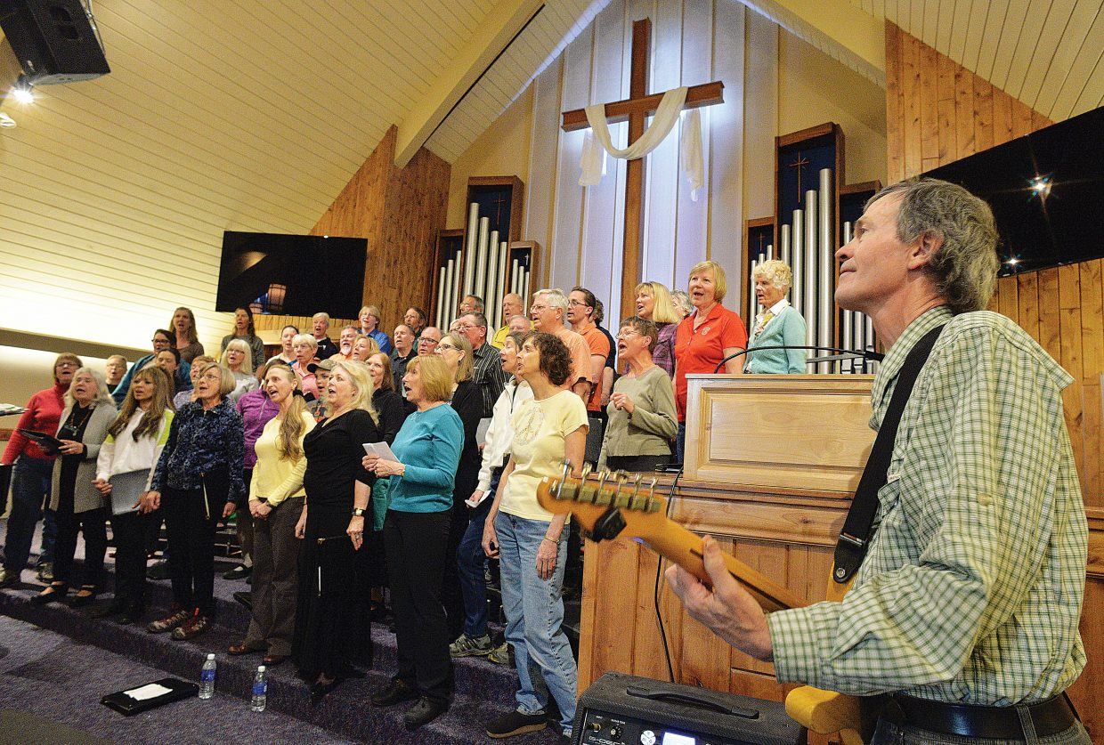 "Musician Randy Kelley plays his guitar along with the Yampa Valley Singers during a rehearsal for the ""I've Been Everywhere"" concert at the United Methodist Church. The group will host two concerts with the first performance at 7 p.m. Friday and a second at 4 p.m. Saturday."