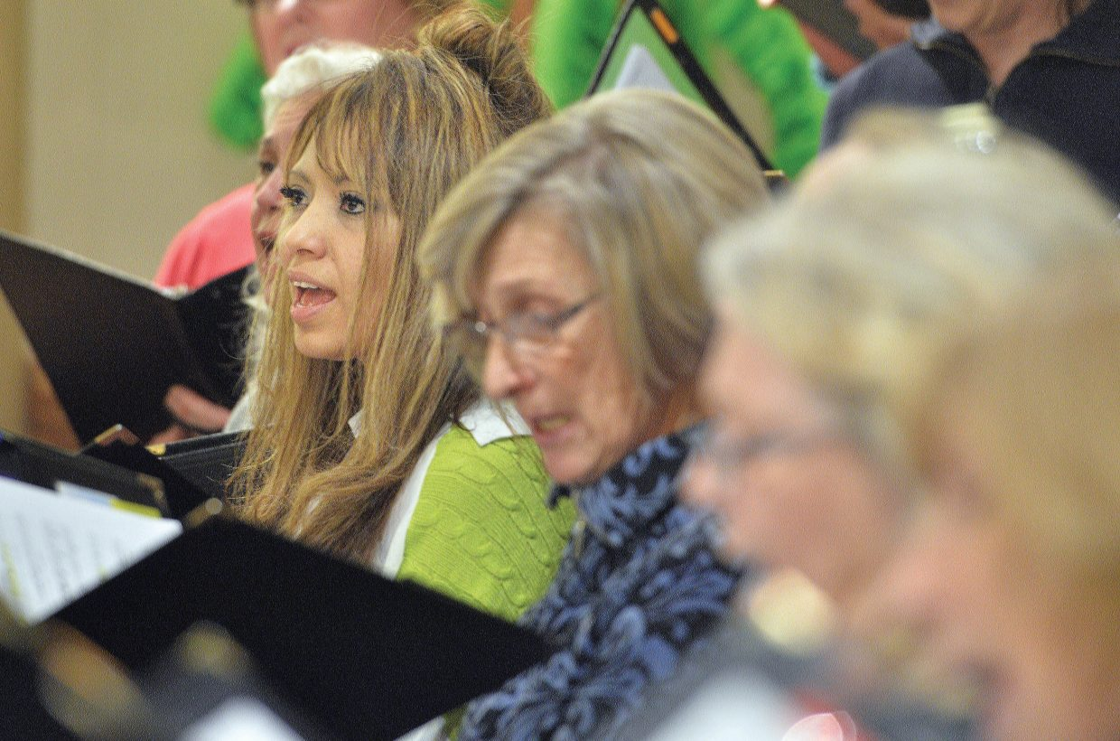 """The Yampa Valley Singers' Scarlett Melendez sings during rehearsal at the United Methodist Church. The community choir will host the """"I've Been Everywhere"""" concerts with the first performance at 7 p.m. Friday and a second at 4 p.m. Saturday."""