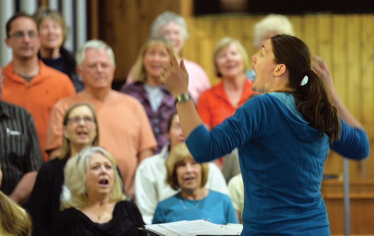 """Anna Williams, director of the Yampa Valley Singers, works to motivate her singers during a classic Beach Boys song during rehearsal at the United Methodist Church. The group will host the """"I've Been Everywhere"""" concerts with the first performance at 7 p.m. Friday and a second at 4 p.m. Saturday."""